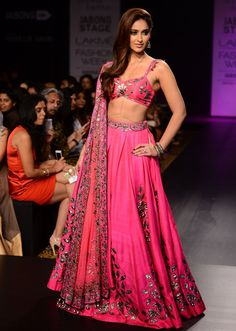 Illena D'Cruz played the showstopper in a pop pink lehenga choil with antique gold work for Arpita Mehta's collection 'Starlight' during Lakmé Fashion Week Winter/Festive 2014.