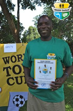 WASH United's partner Nelson Cemiat from Divine Waters proudly presents his certificate: Now a WASH United trainer! (Uganda)