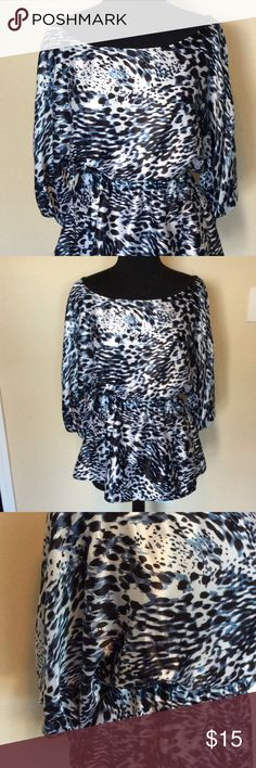 Animal Print Top Animal print blouse. Cinched at the waist. Tie detail at end of sleeve Tops Blouses