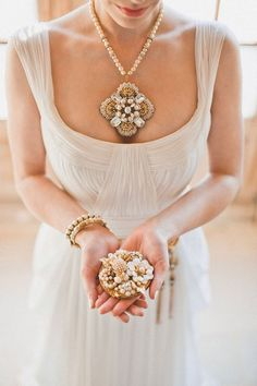Awesome!  Love the pearls! Statement Necklaces to Wow Your Wedding Guests - and look at the ring holder/container!  No ring pillow here!