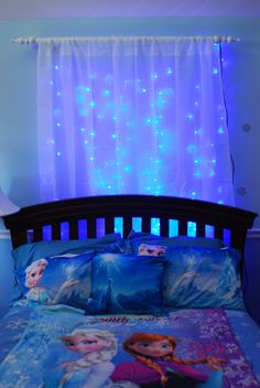 I love the idea of having lights behind the curtain... maybe icicle lights behind a sheer blue curtain? Perfect since my girls are still afraid of the dark!