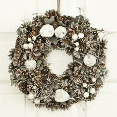 We're getting in the #Christmas spirit with this Pinecone #Wreath.