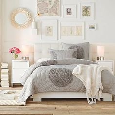 White and natural wood mix--this is similar to the concept I have in mind for my bedroom this summer.  Birch bookshelves (Ikea Billy) either side of the bed, framed photos over headboard, grey spread...