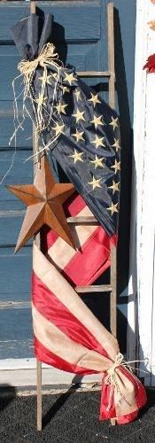 American Falg & a rustic star is nice, but not my style. Maybe a cool tapestry with some glass pieces hanging from the ladder? I would love this