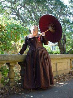 Brown Venetian v front gown. Work it girl!