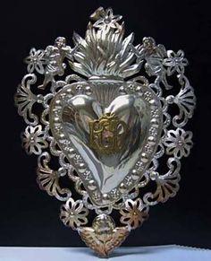 http://www.silvercollection.it/EXVOTO10BIS.jpg