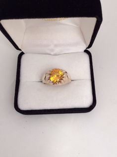 A personal favorite from my Etsy shop https://www.etsy.com/listing/232846397/10k-fine-gold-heavy-mens-citrine