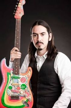 Dhani Harrison with George's famous guitar that he painted himself