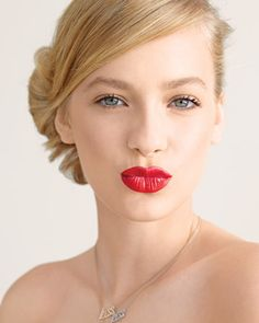 Strong red lips are a classic and ultra-feminine look. To make the color last, fill lips in with matching red liner before applying lipstick