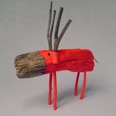Neon red painted driftwood reindeer
