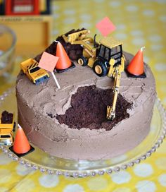Awesome cake for a party with construction cone candles