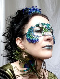 Peacock mask and tiara by GrinGrimaceandSqueek on Deviantart  Wire mask decorated with seed beads.