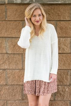 V-neck solid knit sweater cream. This is the perfect everyday easy to wear sweater! Medium weight. Not too light not too heavy. We love it tied at the side worn over a babydoll dress for a trendy Fall