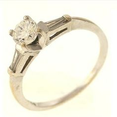 0.58ctw Round Brilliant And Baguette Cut Diamond Ring 18kt White Gold  http://www.propertyroom.com/listing.aspx?l=9451328