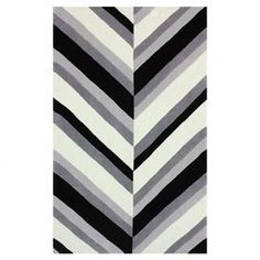 """Bring a touch of modern elegance to your master suite or dining room with this sleek rug, showcasing a chevron-inspired motif in a black palette.    Product: Rug Construction Material: 100% Polyester Color: Black, gray and white Features: Hand-tufted Pile Height: 0.5""""  Note: Please be aware that actual colors may vary from those shown on your screen. Accent rugs may also not show the entire pattern that the corresponding area rugs have. Cleaning and Care: Spot treat with a mild ..."""