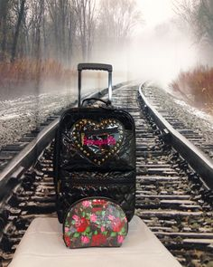 Is your graduate ready for a new adventure? Send them away with a Black Betseyville by Betsey Johnson 'Be Mine' Rolling Suitcase and a Floral Betsey Johnson make up bag! #betseyjohnson #betseyjohnsonluggage #clotheshorsecarousel #consignmentboutique