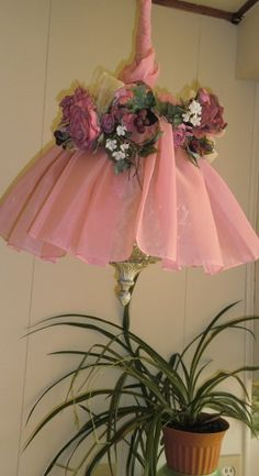 Do you have an UGLLLLY 1970's hanging lamp?  So, did I=two curtain valances, and some silk flowers, made me happier!