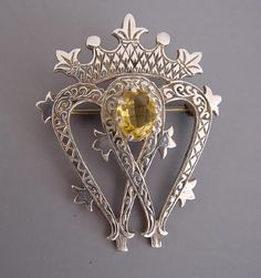 Scottish Luckenbooth crown and double hearts brooch hallmarked Iona, Scotland Edinburgh, date illegible but circa A Luckenbooth symbolizes love and protection from evil spirits. Royal Jewels, Crown Jewels, Tartan, Antique Jewelry, Vintage Jewelry, Scottish Dress, Fine Jewelry, Women Jewelry, Personalized Jewelry