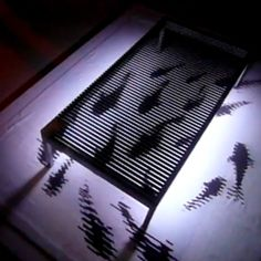 Magic Carp-pet Rug, uses the Moire effect on a coffee table to make the fish appear to be swimming