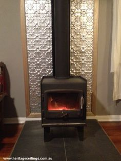 Pressed tin panels used as a fire place