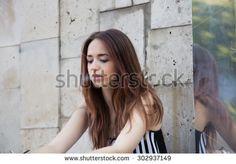 Smoking girl on the street - stock photo #fashion #fashionphoto #girls #women #streetfashion #people #brunette #posing #beauty #trend #look #designer #young #smoke #smoking #hair #makeup by Elizaveta Soldatenko