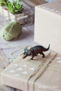 Stamped craft paper + yarn wrapped gift