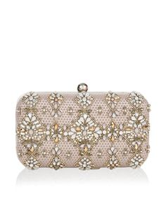 Our beautifully ornate Elsa embellished hard-case clutch bag is decorated with lustrous crystal gems, jewels and beads in diamond-shaped motifs. This luxe pi...