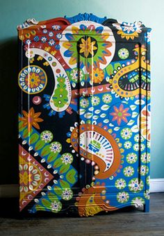 This whimsical armoire was hand-painted by an amazing artist named LUCAS RISÉ.