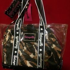 NWT Betseyville Clare Tories with animal lining NWT Betseyville clear tote with snap animal lining. Never used but due being at the bottom of my closet it has been scratched at bottom part in both sides but other then nothing wrong with bag . Betsey Johnson Bags