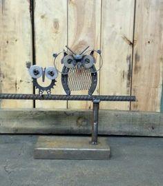 Scrap metal sculpture,  yard art, horse shoe, sprocket, big glasses, garden art, tig welded.