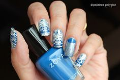 """Nail Art  Blue and Silver stamping with embossed effect [NEW CHALLENGE!]   Hello my lovelies! Happy Friday and happy new nail art challenge!  Last week I was wondering how I was going to find the inspiration to fill every Friday nail art post when all of a sudden I found out there is a new Challenge launching today! This is the """"26 Great nail art Ideas"""" challenge and it will run every other Friday for one year. I am so excited!  Shall we begin?  I like that this challenge has a lower…"""