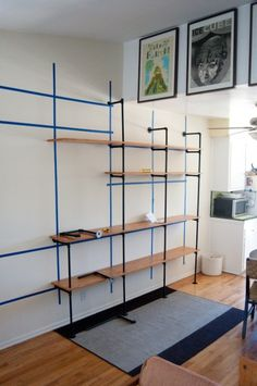 This DIY shelving would be a great fix for the basement with the weird mixed ceiling heights