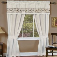 "Ivory.  Faux Silk Five Piece ""Window In A Bag"" Set. Faux silk sophisticated look with heavy medallion embroidery and triple pleating on the valance. Requires just one standard or decorative rod. Set Includes: 2 Panels 1 Attached Decorative Valance 2 Tiebacks"