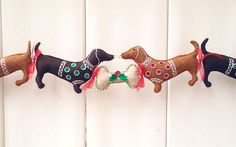 Dachshund Christmas Garland Doxie by PatriciaWelchDesigns on Etsy, $100.00.....on my wish list.