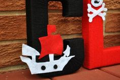 """Felt pirate ship on a yarn wrapped letter """"C""""! Yarn Wrapped Letters, Yarn Letters, Letter C, Hermes Oran, Monograms, Drink Sleeves, Felt, Ship, Decorating"""