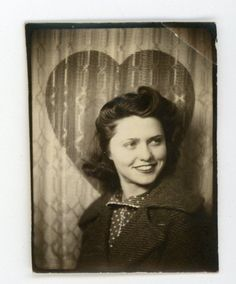 Pretty smiling girl - heart backdrop. Vintage photobooth  snapshot photo booth
