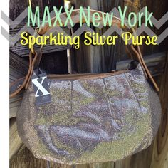 SALEMAXX New York silversparkling handbag! Never been carried! Still has paper on the inside. This purse definitely makes a statement. If you love blingthen this is for you! Has silver sparkle all over it! Gold hardware! I would say it is a medium/large bag! Zipper pocket on the inside! In great condition! I have never seen another purse like this! This is a steal retails for $275+((STILL HAS TAGS))One of a kind!PRICED TO SALE PLEASE ASK ANY QUESTIONS BEFORE PURCHASING...          PRICED TO…