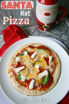 Such a fun food idea for the holidays!  Santa Hat Pizza!