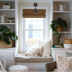 Gorgeous window seat between white built-ins.