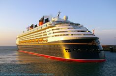 MS Disney Magic Cruise Ship at Sunrise, Western Entrance, Dover Harbour, Kent, England, UK. Vessel owned by Disney Cruise Line. Arrived from Lisbon (Portugal) en route to Oslo (Norway). Ship data: Call Sign C6PT7, IMO 9126807, MMSI 308516000; Registered Nassau (Bahamas). View from Prince of Wales Pier with English Channel (left) and Admiralty Pier (right). A Port of Dover travel, tourism, and holiday photo. More information at http://www.panoramio.com/photo/37069020