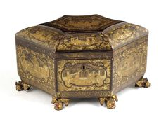 A mid 19th century Chinese export lacquer tea chest, decorated in gilt with panels of figures in domestic settings, the interior with pewter twin lidded pull-out canisters, 6¾in (17cm) high, 13in (33cm) wide, 8½in (21.4cm) deep.