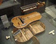 """This photograph, taken by E.Puzzovio in the Paris Museum, is of an 'exploded' J. Louvet and is dated 1733. The label reads: """"Vielle à roue, Jean Louvet, Paris, 1733, Acquis en 1890, E 1412 (?). Cette vielle a été faite à partir d'une caisse de guitare. La table d'harmonie (dont on aperçoit la trace de la rose) a été emplyée pour renforcer l'intérieur du fond."""""""