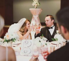 cheers at the table Loved this romantic shoot at FORUM Conference & Events Center! Created by Plum & Poppy Weddings, Blu3 Designs, Heavenly Sweets Cakes/Noblesville, Indiana, Hand Tied Memories | Wedding Floral Creations by Marta, Louie's Tux Shop, Huff Photography, Linen Hero by Chair Covers and Linens, Vibe Video Productions, Aveda-In Touch 20, CORT, Violet Vintage and M.H.Pomander's