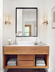 Modern White Powder Room with Porcelain Sconces