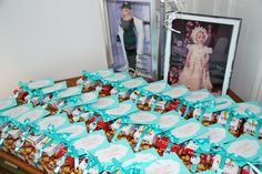 Party Favors inspired by Breakfast at Tiffany's: Cracker Jacks, Candy Cigarettes, a Audrey Hepburn pin all tied up with a Tiffany Blue ribbon and an Audrey quote.