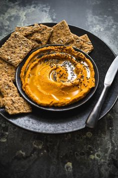 This Smoky Pumpkin & Black Sesame Seed Hummus is the perfect fall appetizer or an easy dinner with a side of chopped veggies and chips. This orange and black dip is also festive and perfect for Halloween parties!