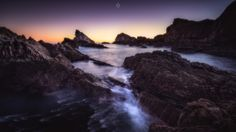 Glowing Rocks - A long exposure, landscape image of rocks at low tide on the shore of Portknockie in Morayshire, Scotland, at sunrise.