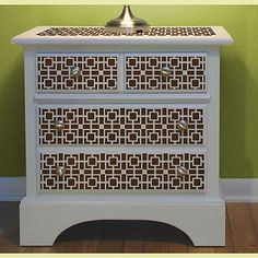 Great idea for saving money on backsplash tiles, or to dress up old furniture-- use a stencil pattern!