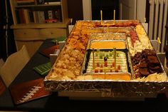 Snackadium- Super Bowl goodies  The snackadium, a snacker's dream, is an edible stadium filled to the brim with chips, dips and even dessert.