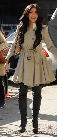 Who made Kim Kardashian's black thigh high boots, pleated trench coat, and black handbag that she wore in New York on March 27, 2011?